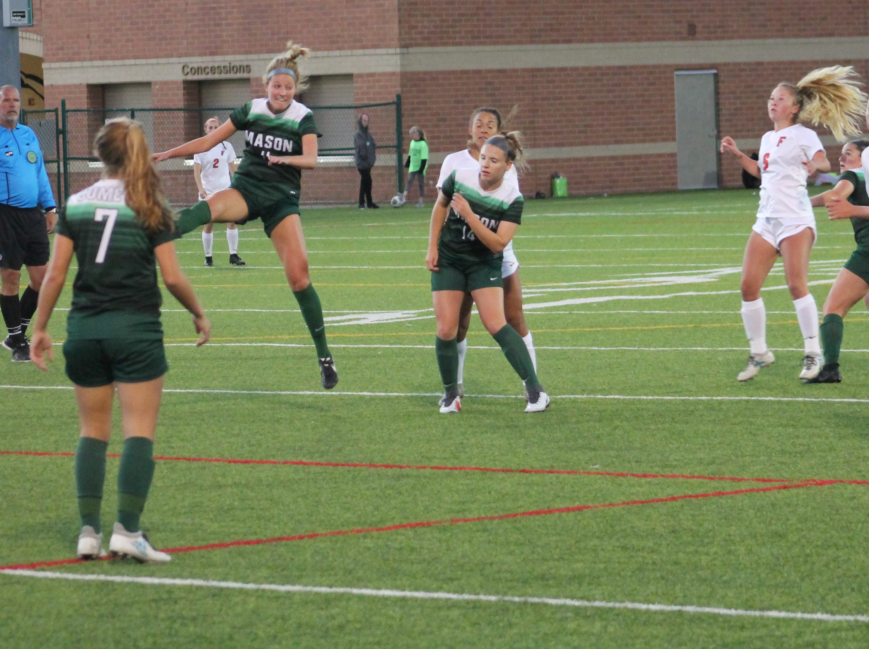 Mason senior forward Jenna Burns goes high in the air for the ball in the Lady Comets 1-0 victory over Fairfield Oct. 12