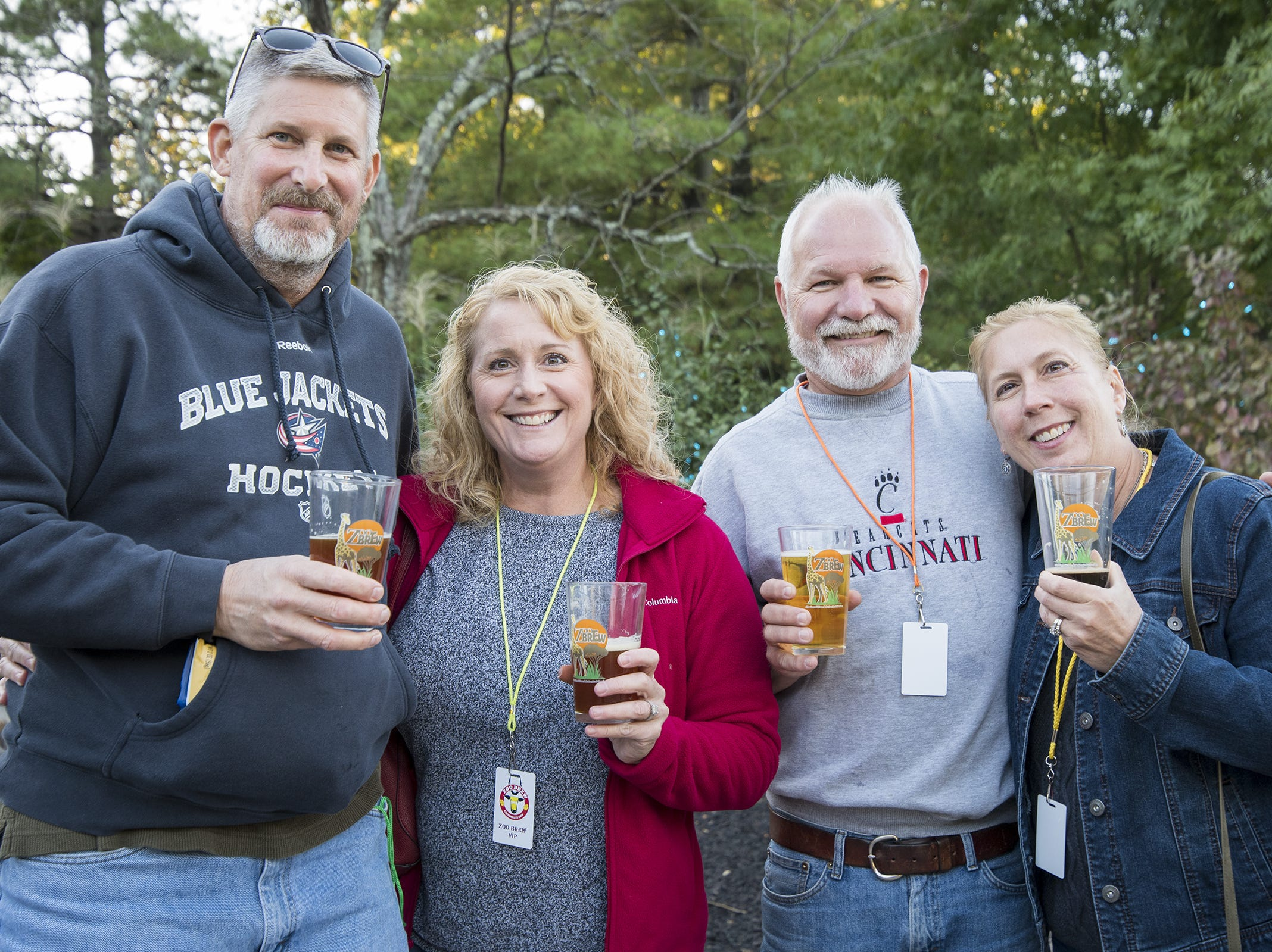 Ken Forny, Amy Uln and Andy and Lisa Huizing attend Zoo Brew.