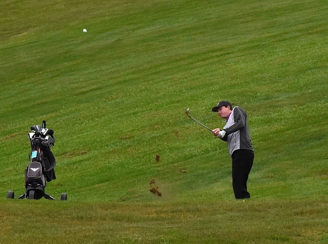 Lakota East's Brock Eaton eyes an approach shot on the front nine at the 2018 Southwest District Golf Tournament in Beavercreek, Ohio, October 11, 2018.