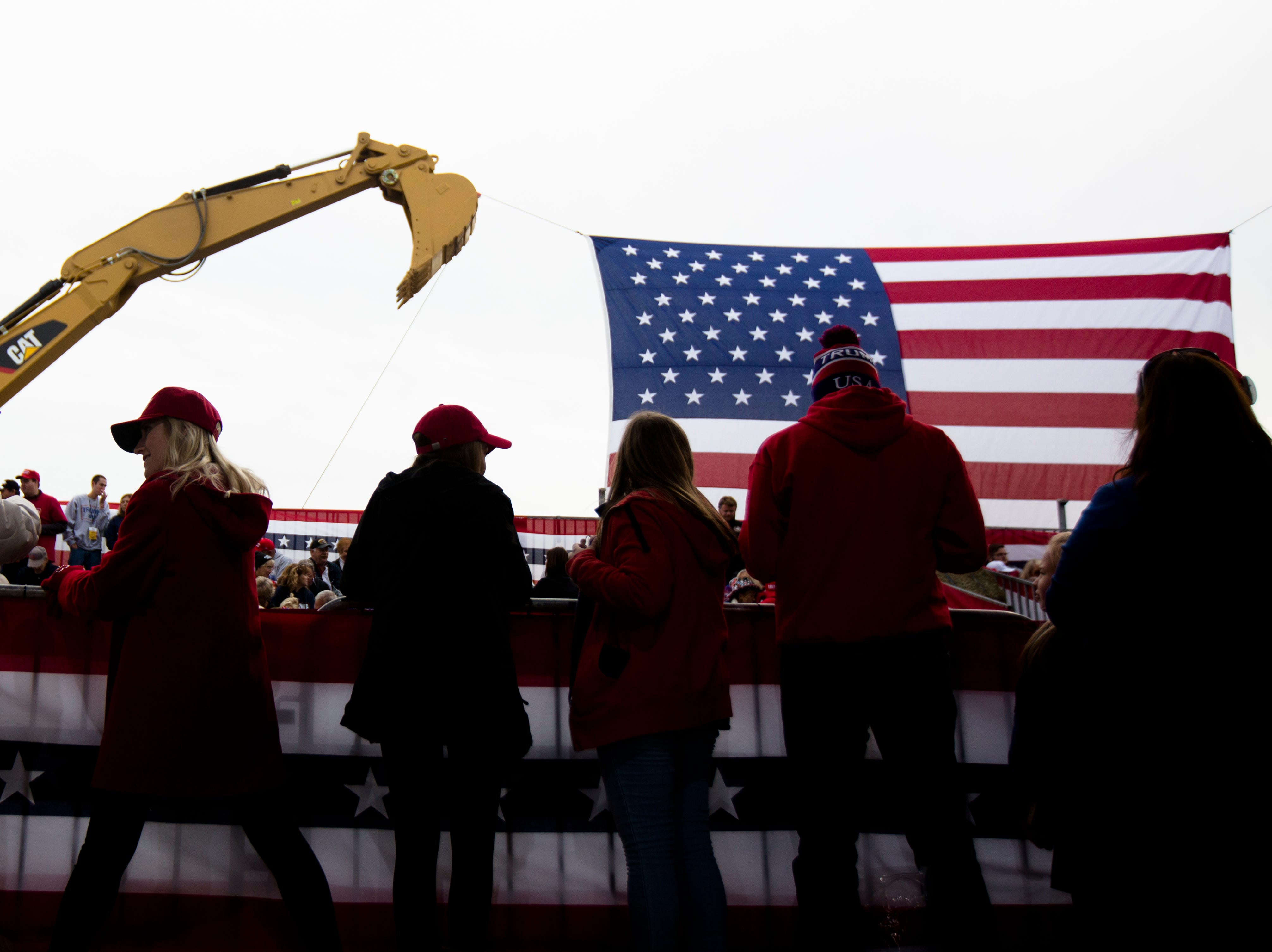 People wait for the President at President Donald J. Trump's Make America Great Again Rally in Lebanon, Ohio, on Friday, Oct. 12, 2018.
