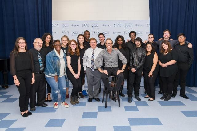 Alumnus Alan Paul '71, '92H, founding member of The Manhattan Transfer, poses with Music Conservatory students.