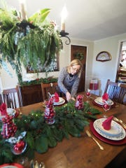 Long-time Holly Trail member Beryl Gandolfo puts the finishing touches on the table before the guests arrive.