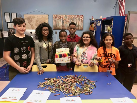 21st Century Community Learning Center students who are helping to collect crayons to be recycled. (From left) Alejandro Carro-Quesada, Tyasia Knight, Samantha DaVilma, Angelo Charles, Marisol Ramos-Rodriguez, Leilani Ocasio-Cuevas, and Nafis Chandler-Pankey.