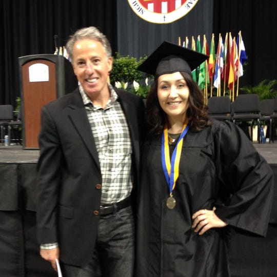 Tom Wolff and Nicole Zeien-Cox at the Mount Mercy graduation ceremony last year, where Zeien-Cox earned a bachelor's in business administration.