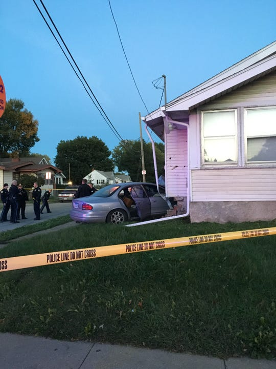 After a short pursuit, a car crashed into a home at the corner of Arthur Ave. and E. 14th St. leaving the driver in critical condition.