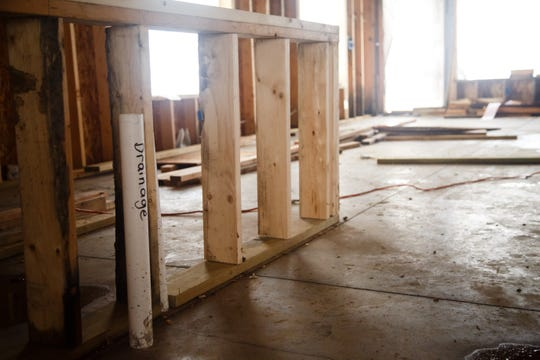 The kitchen sits unfinished in what was supposed to be Krystal and Rusty Armstrong's dream home on Wednesday, Oct. 10, 2018, south of Indianola. They say contractor Dave Daughenbaugh has taken their money for work to be done but has walked off the job and left them with a shell of a building.