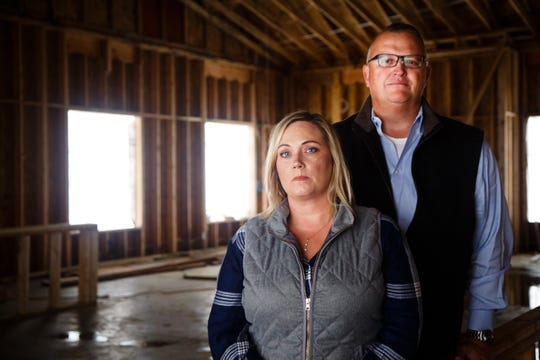 Krystal and Rusty Armstrong at what was supposed to be their dream home on Wednesday, Oct. 10, 2018, south of Indianola. They say contractor Dave Daughenbaugh has taken their money for work to be done but has walked off the job and left them with a shell of a building.