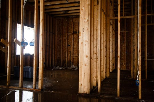 A window illuminates what should be Krystal and Rusty Armstrong's master bedroom in their unfinished dream home on Wednesday, Oct. 10, 2018, south of Indianola. They say contractor Dave Daughenbaugh has taken their money for work to be done but has walked off the job and left them with a shell of a building.
