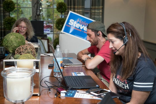 Nessa Feller of Birmingham, right, Jacob Stern of Boston, Mass., center, and Janet Street of Bloomfield Township, make phone calls to voters to campaign for Haley Stevens in Bloomfield Township, Wednesday, October 10, 2018.