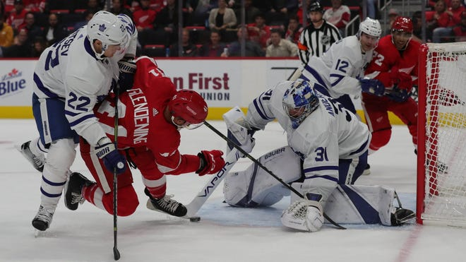 Detroit Red Wings center Luke Glendening shoots against Toronto Maple Leafs goalie Frederik Andersen during third period action Thursday, October 11, 2018 at Little Caesars Arena in Detroit, Mich.