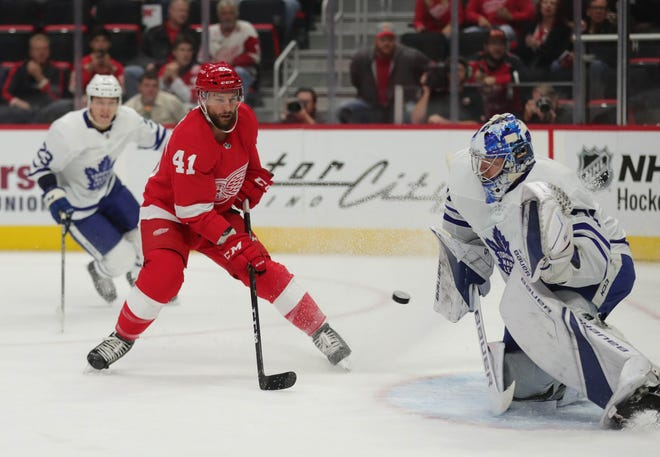 Detroit Red Wings center Luke Glendening shoots against Toronto Maple Leafs goalie Frederik Andersen during first period action Thursday, Oct. 11, 2018 at Little Caesars Arena in Detroit, Mich.