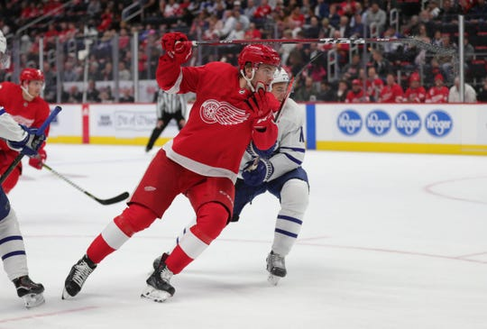 Detroit Red Wings center Michael Rasmussen skates against Toronto Maple Leafs center Zach Hyman during third period action Thursday, October 11, 2018 at Little Caesars Arena in Detroit, Mich.