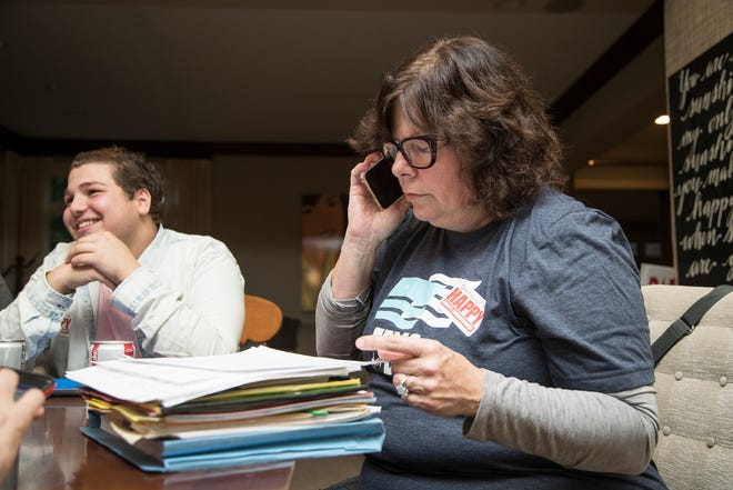 Lori Goldman, right, makes phone calls to voters at her home in Bloomfield Township, Wednesday, October 10, 2018. Next to her is Nash Salami of Bloomfield Township.