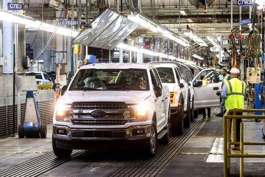 Ford F-150 trucks come off the assembly line at the Ford Rouge Plant in Dearborn on Thursday, September 27, 2018.