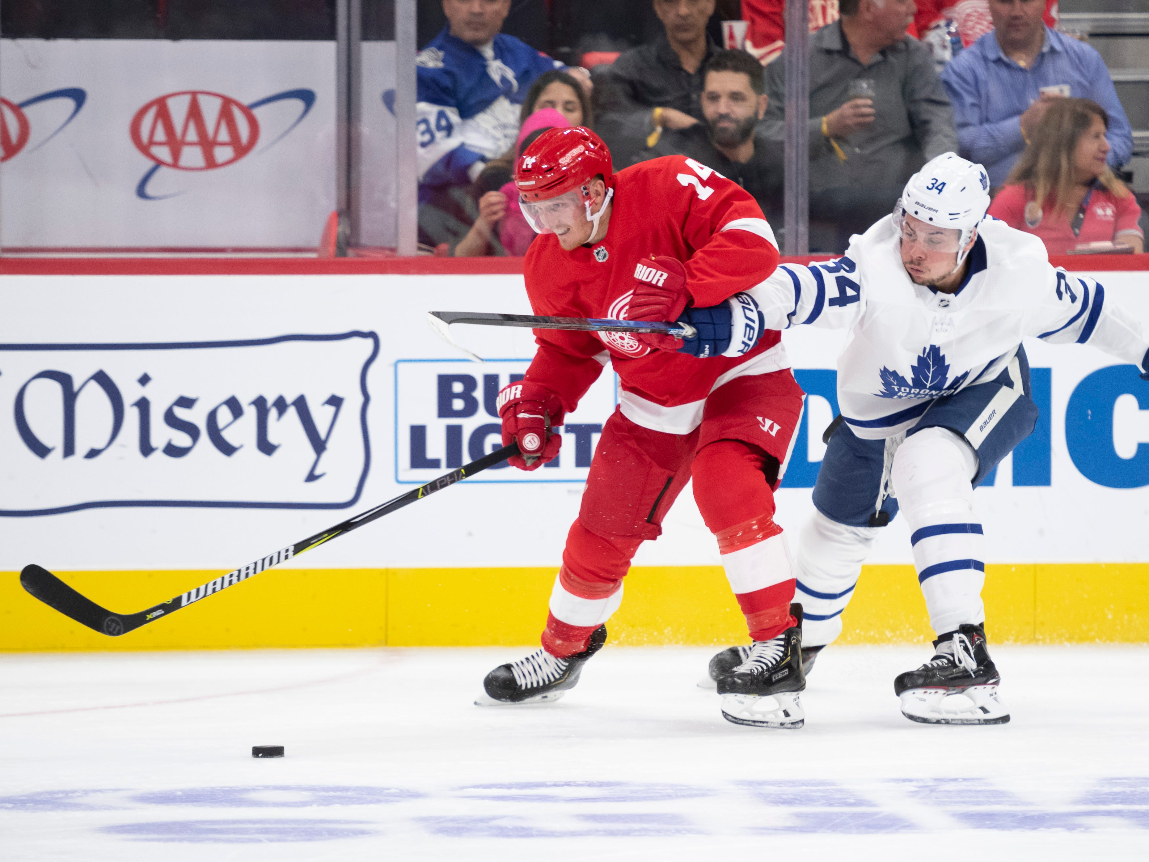 Toronto center Auston Matthews received a holding penalty on this play with Detroit center Gustav Nyquist the second period.
