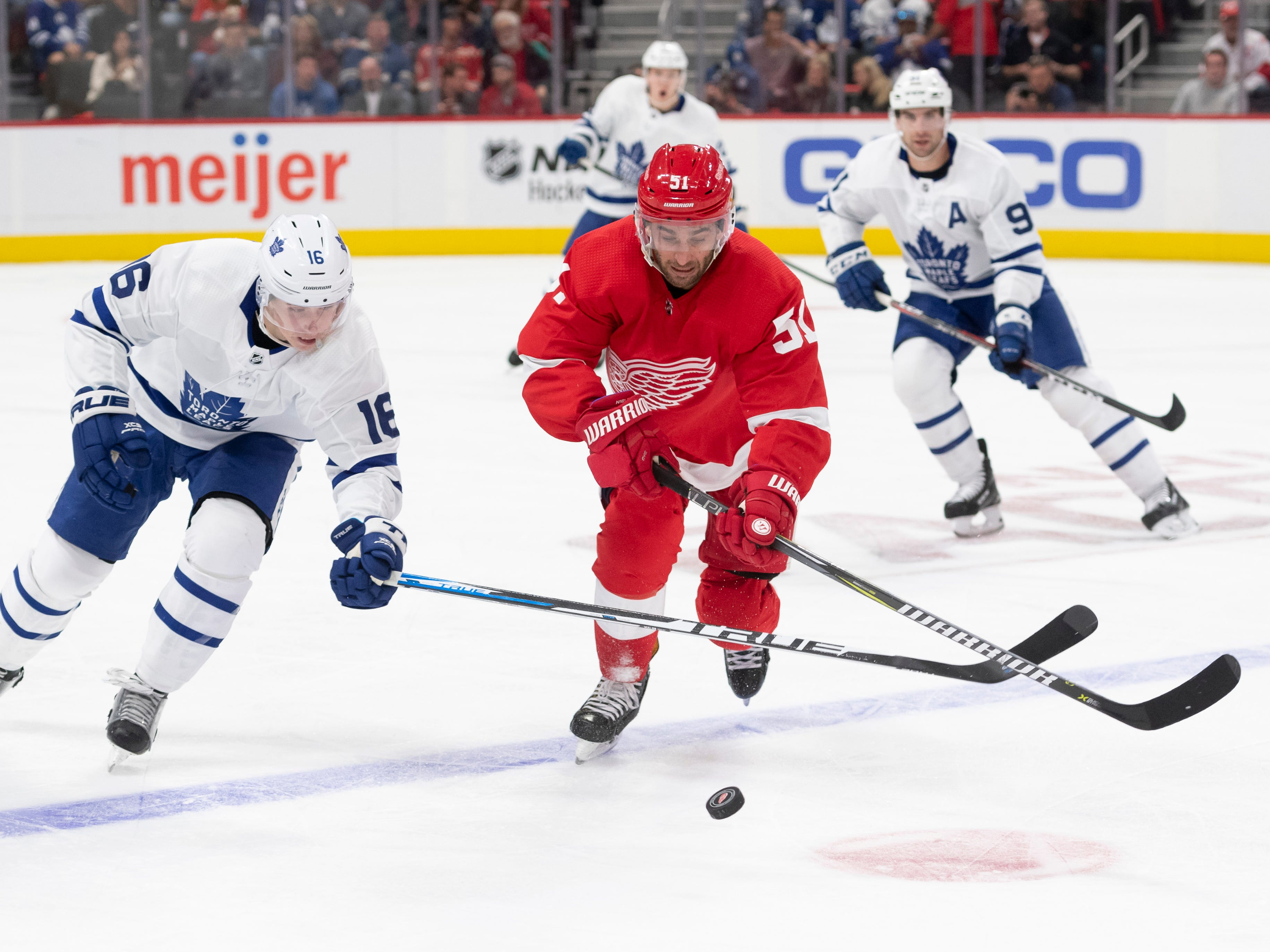 Toronto center Mitch Marner and Detroit center Frans Nielsen battle for the puck the second period.