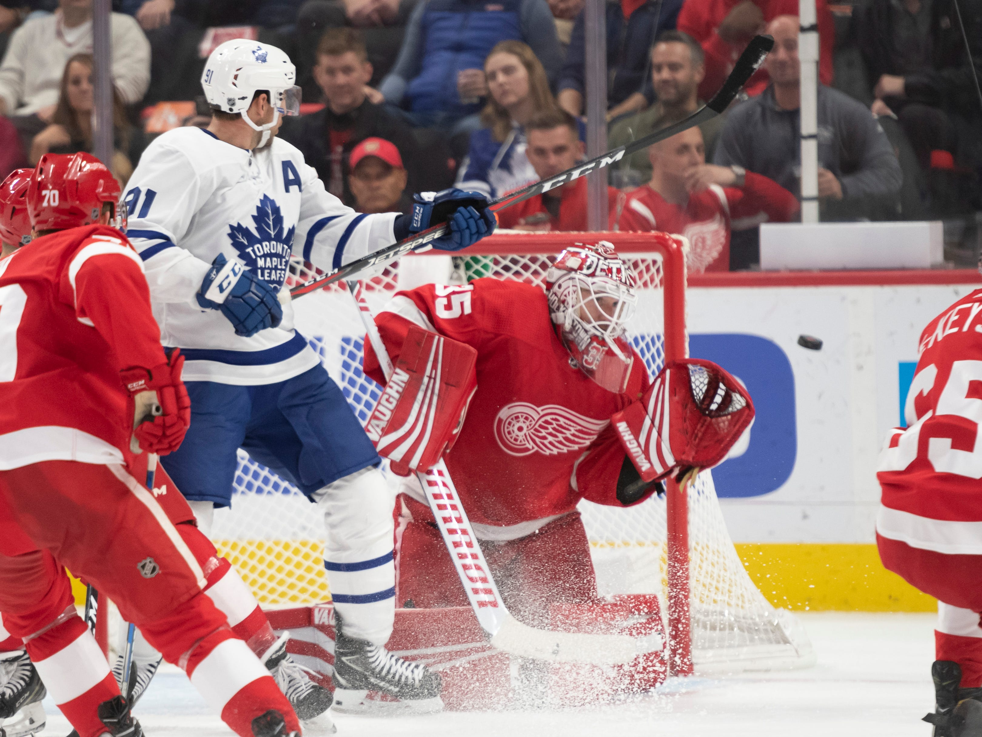 Toronto center John Tavares tries to deflect the puck past Detroit goaltender Jimmy Howard the second period.