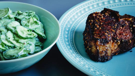 Coffee goes into the rub for these lamb chops, in the form of espresso powdered mixed into the ground chile, sesame seeds, dried onion and spices. A simple side of cucumbers in sour cream dressing acts as cooling agent.