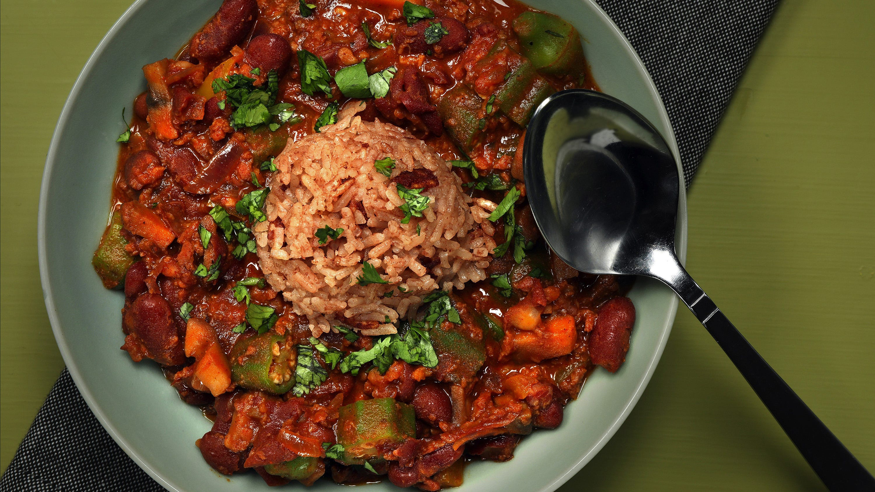 The red beans and chorizo stew tastes great topped with a scoop of red rice. Okra gives the stew additional texture. (Shannon Kinsella/food styling) (Terrence Antonio James/Chicago Tribune/TNS)