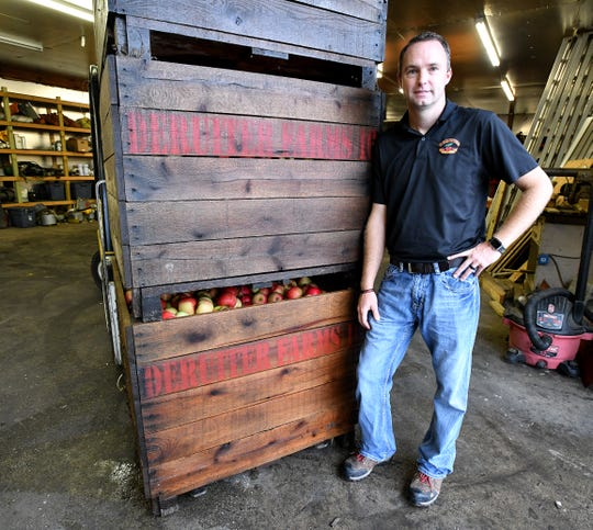 Cherry producer Mike DeRuiter, seen here with his apple harvest, is at a quandry after watching cherry prices fall and imports from Turkey flood the US market in the last five years. DeRuiter and his family produce fruit on their farms near Hart, MI on Michigan's west coast.