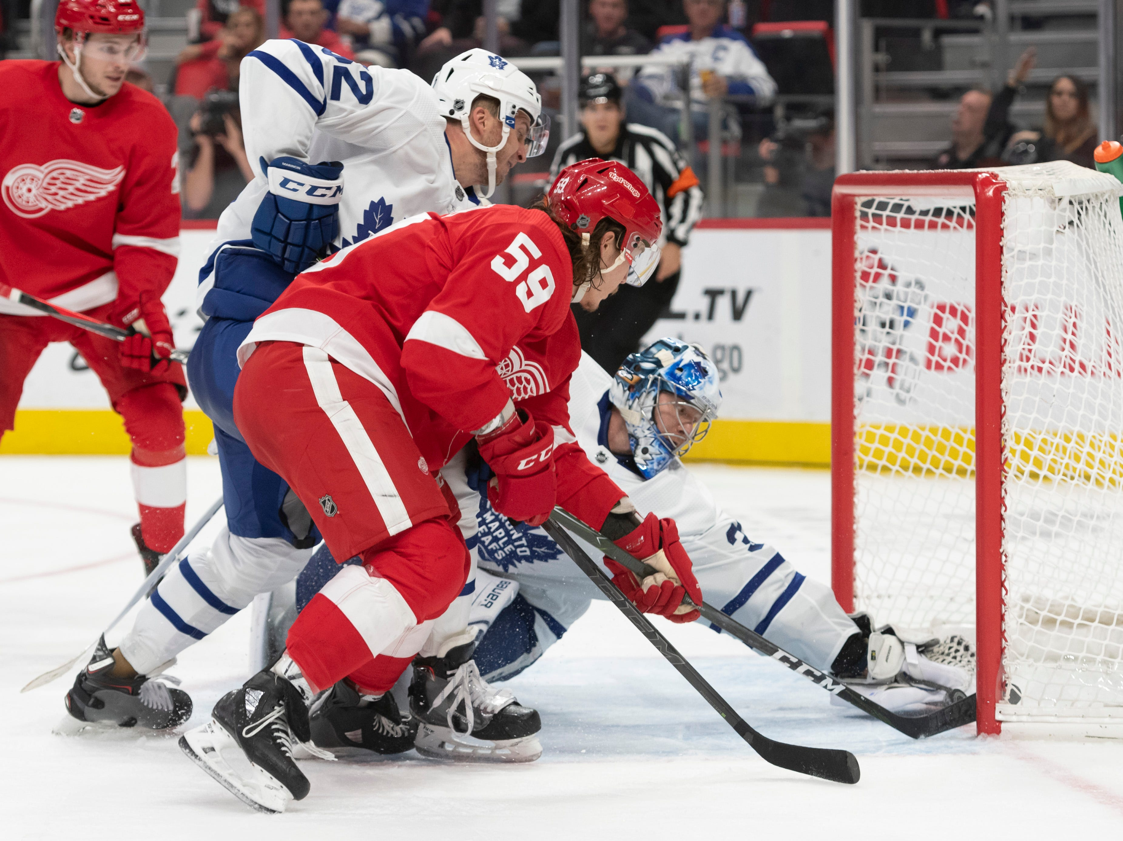 A shot by Detroit center Dylan Larkin (not pictured) slips past Toronto goaltender Frederik Andersen for a goal as Detroit left wing Tyler Bertuzzi tries to help it in during the third period.