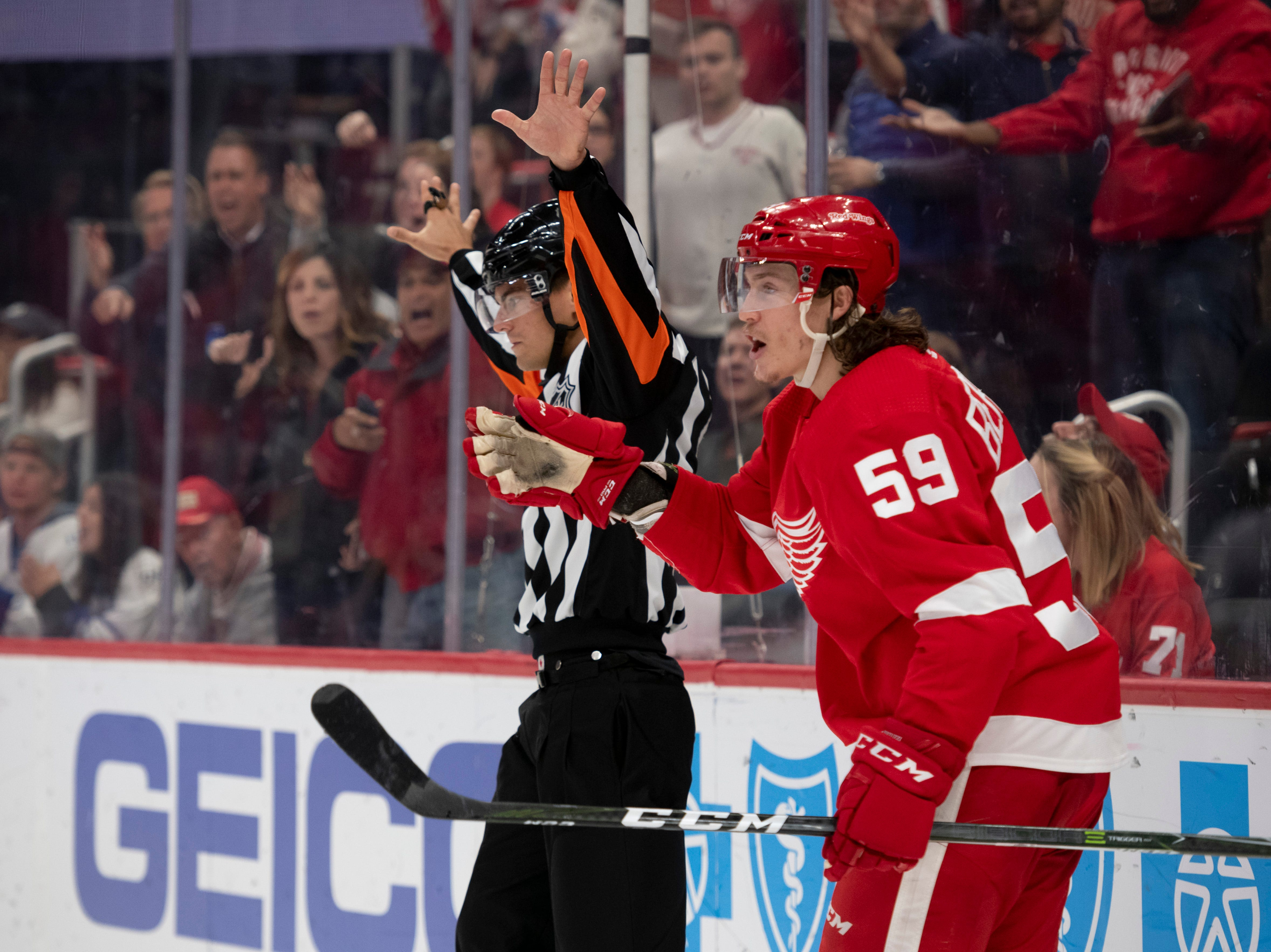 Detroit left wing Tyler Bertuzzi argues with referee Kendrick Nicholson after a shot by teammate Dylan Larkin went into the net during the third period.  The play was eventually ruled a goal.