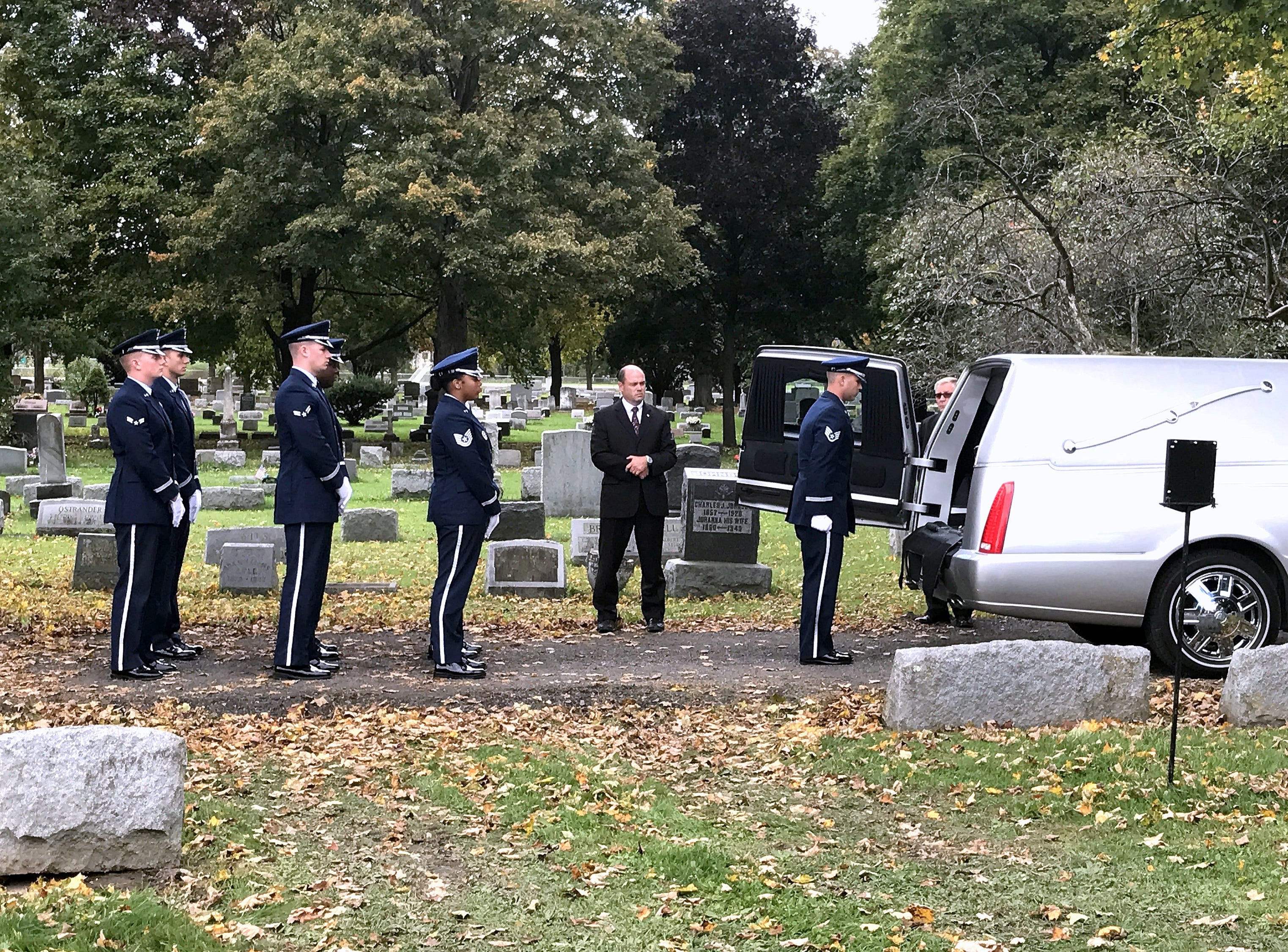 Military pallbearers prepare to remove the body of U.S. Air Force Staff Sgt. Eugene Costley from a hearse Friday at Maple Grove Cemetery in Horseheads.