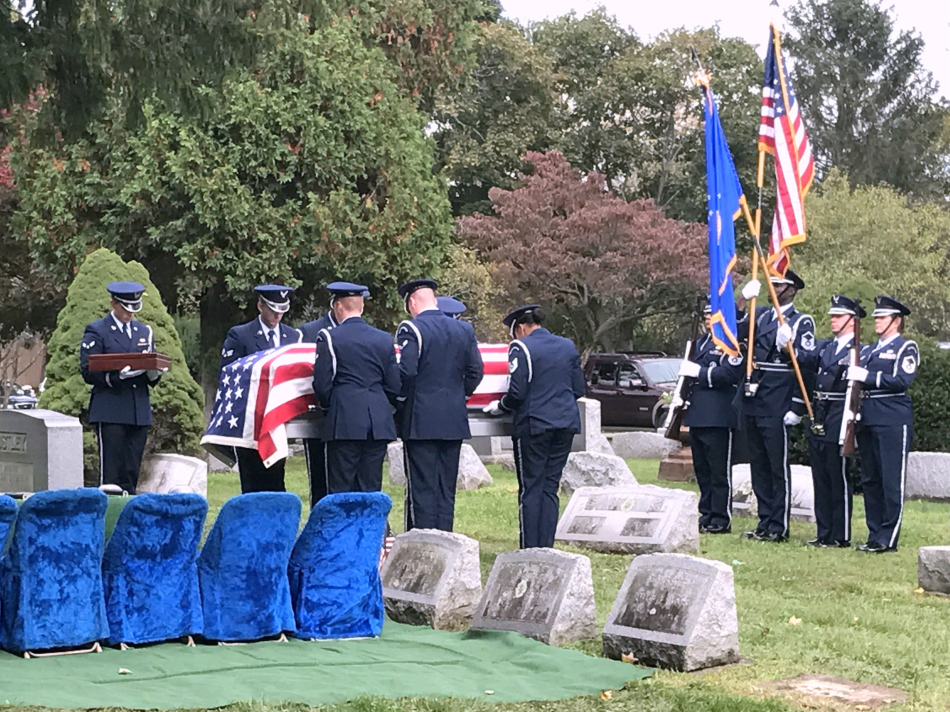 Military personnel hold the remains of Elmira native Eugene Costley, who was killed in a 1952 plane crash, during his funeral Friday.