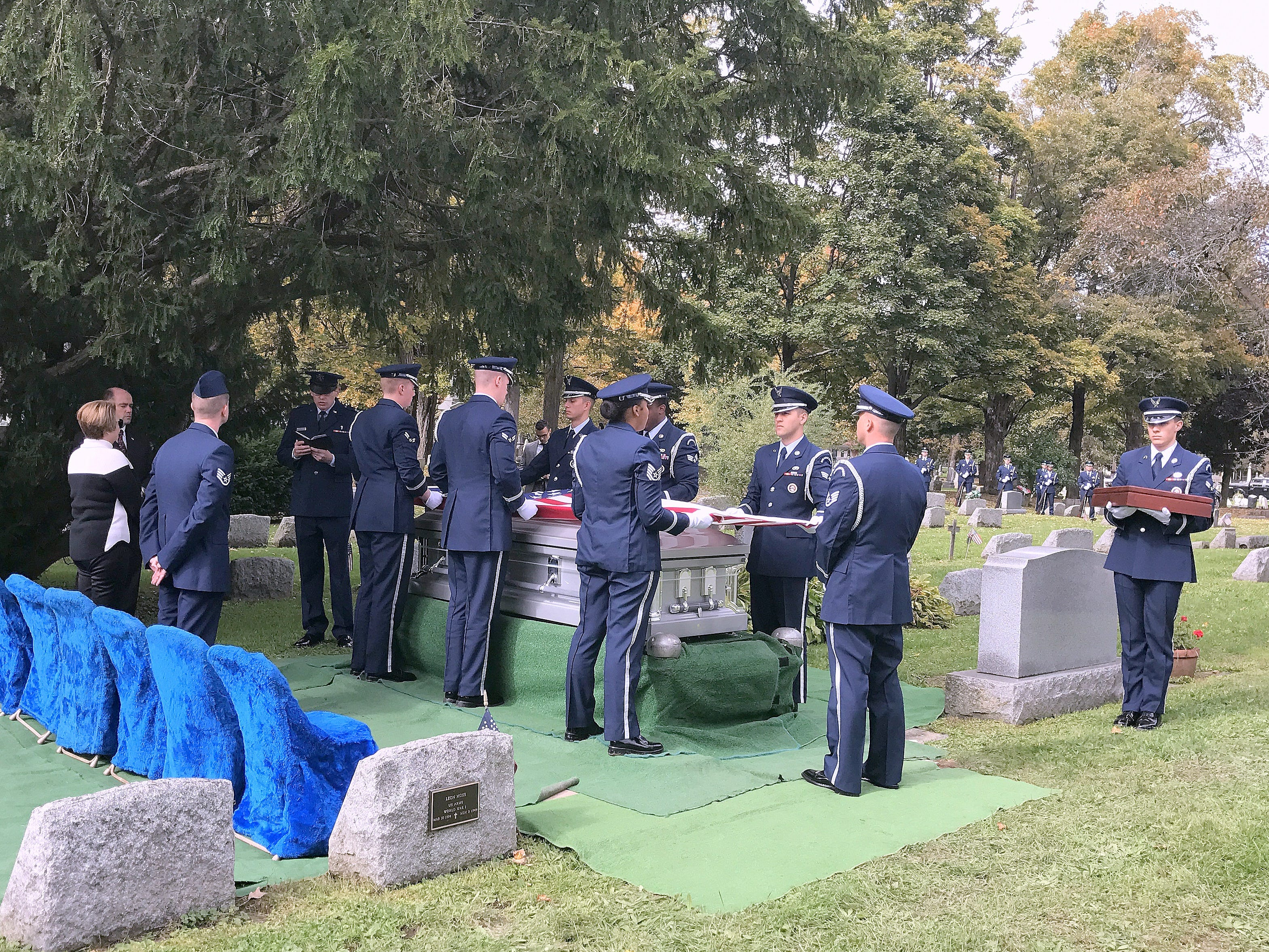 Pallbearers prepare to fold the American flag draped over the coffin of U.S. Air Force Staff Sgt. Eugene Costley during his funeral Friday at Maple Grove Cemetery in Horseheads.