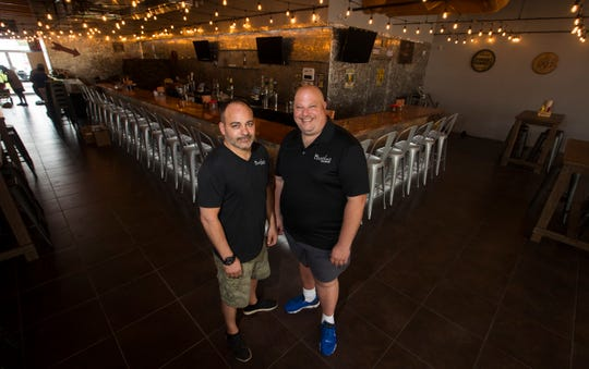The new Backyard Beer Garden in downtown Cape Coral, is co-owned by Gabe Ferraro, left, and Chris Ilardi. The restaurant will open to the public on Wednesday, Oct. 17, 2018.