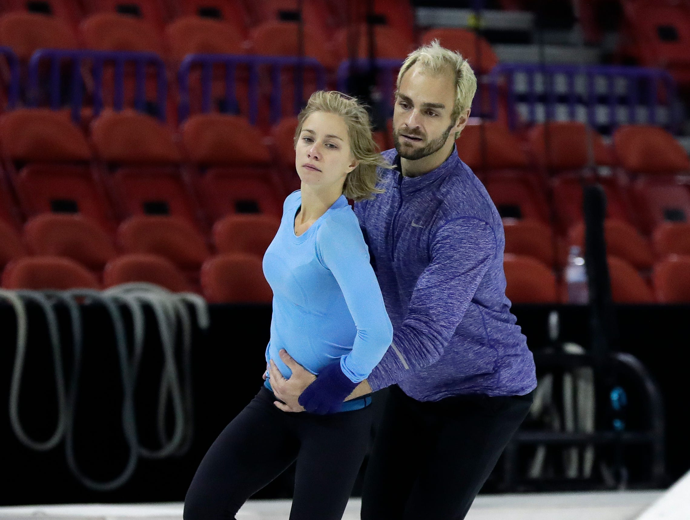 """Cirque du Soleil's """"Crystal"""" performers practice skating before the first performance Oct. 11, 2018 at the Resch Center in Ashwaubenon, Wis."""