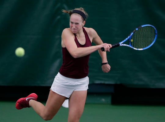 Fond du Lac's Kellie Hierl plays in a Division 1 singles match at the WIAA state girls tennis tournament.