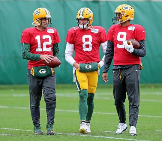 Green Bay Packers quarterback Aaron Rodgers (12), quarterback Tim Boyle (8) and quarterback DeShone Kizer (9) talk during practice on Clarke Hinkle Field Friday, October 12, 2018 in Ashwaubenon, Wis.