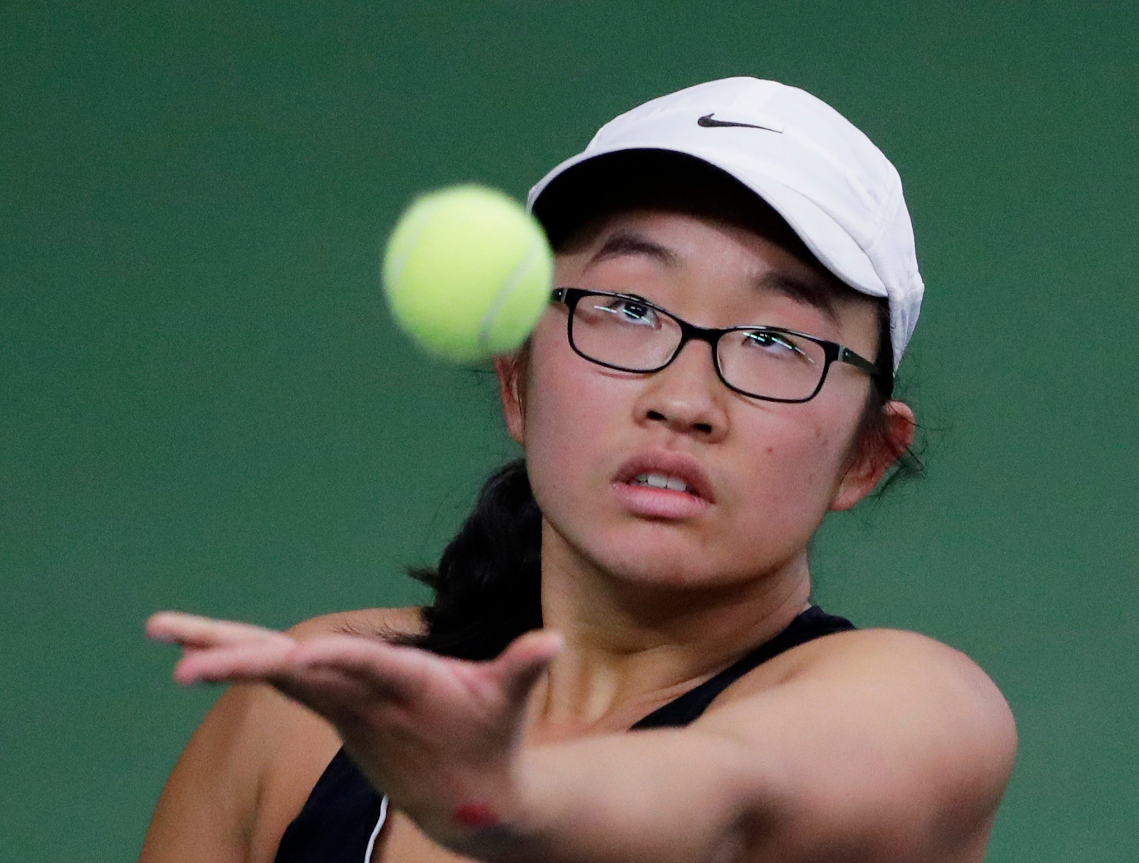 Stevens Point's Sabrina Tang serves in a Division 1 singles match at WIAA 2018 Girls State Tennis Tournament at Nielsen Tennis Stadium on Friday, October 12, 2018 in Madison, Wis.