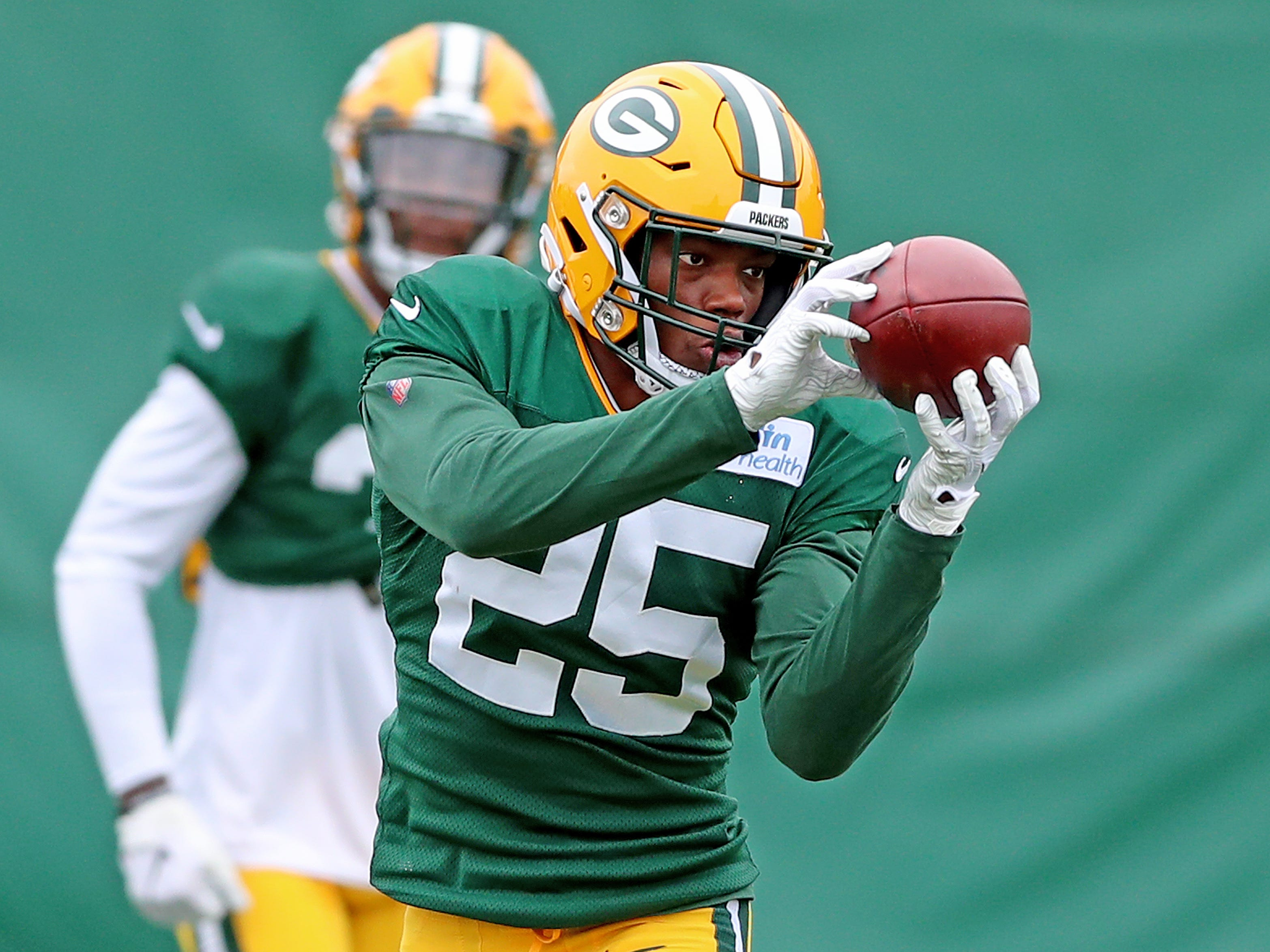 Green Bay Packers defensive back Will Redmond (25) catches a ball during practice on Clarke Hinkle Field Friday, October 12, 2018 in Ashwaubenon, Wis.