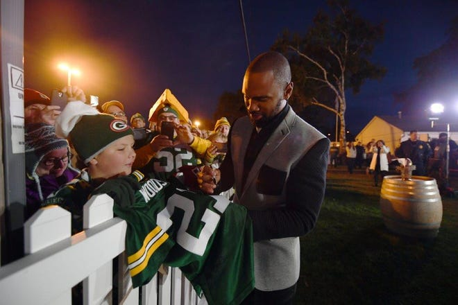 """Former Green Bay Packers defensive back Charles Woodson interacts with fans during a 2017 visit by ESPN's """"Monday Night Countdown"""" outside the Tundra Trio near Lambeau Field."""