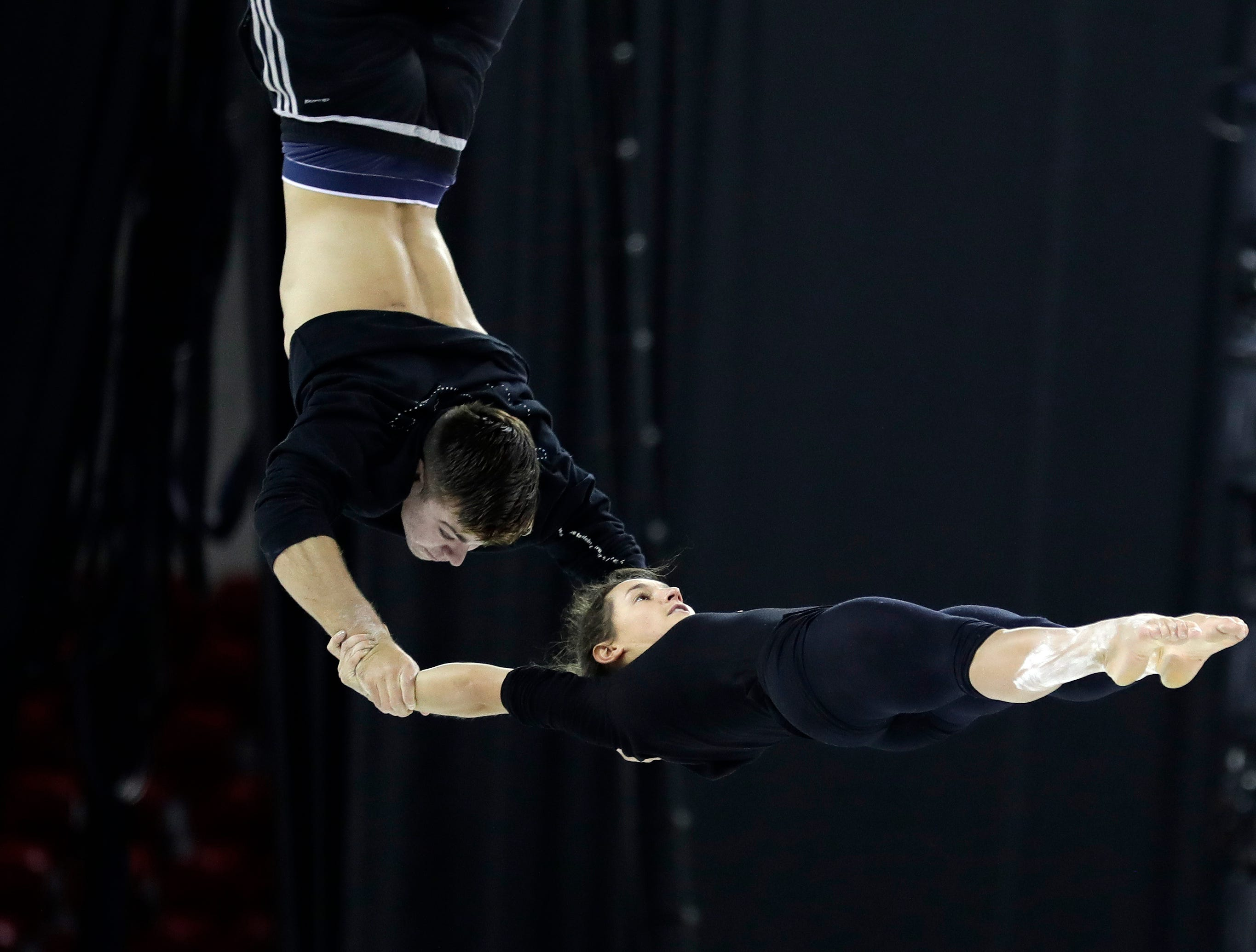 """Cirque du Soleil's """"Crystal"""" performers practice their routine Oct. 11, 2018 before the first of six shows being held at the Resch Center in Ashwaubenon, Wis."""