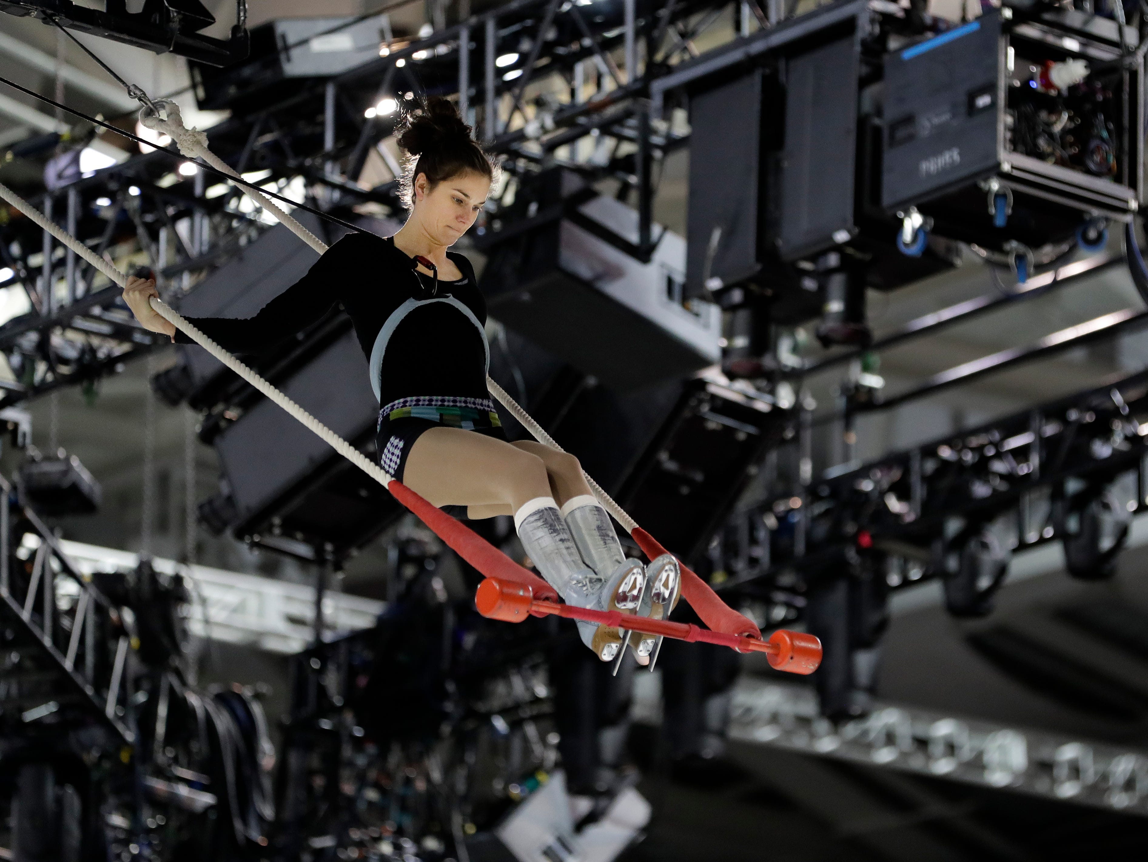 """A Cirque du Soleil's """"Crystal"""" performer practices her routine Oct. 11, 2018 before the first of six shows being held at the Resch Center in Ashwaubenon, Wis."""