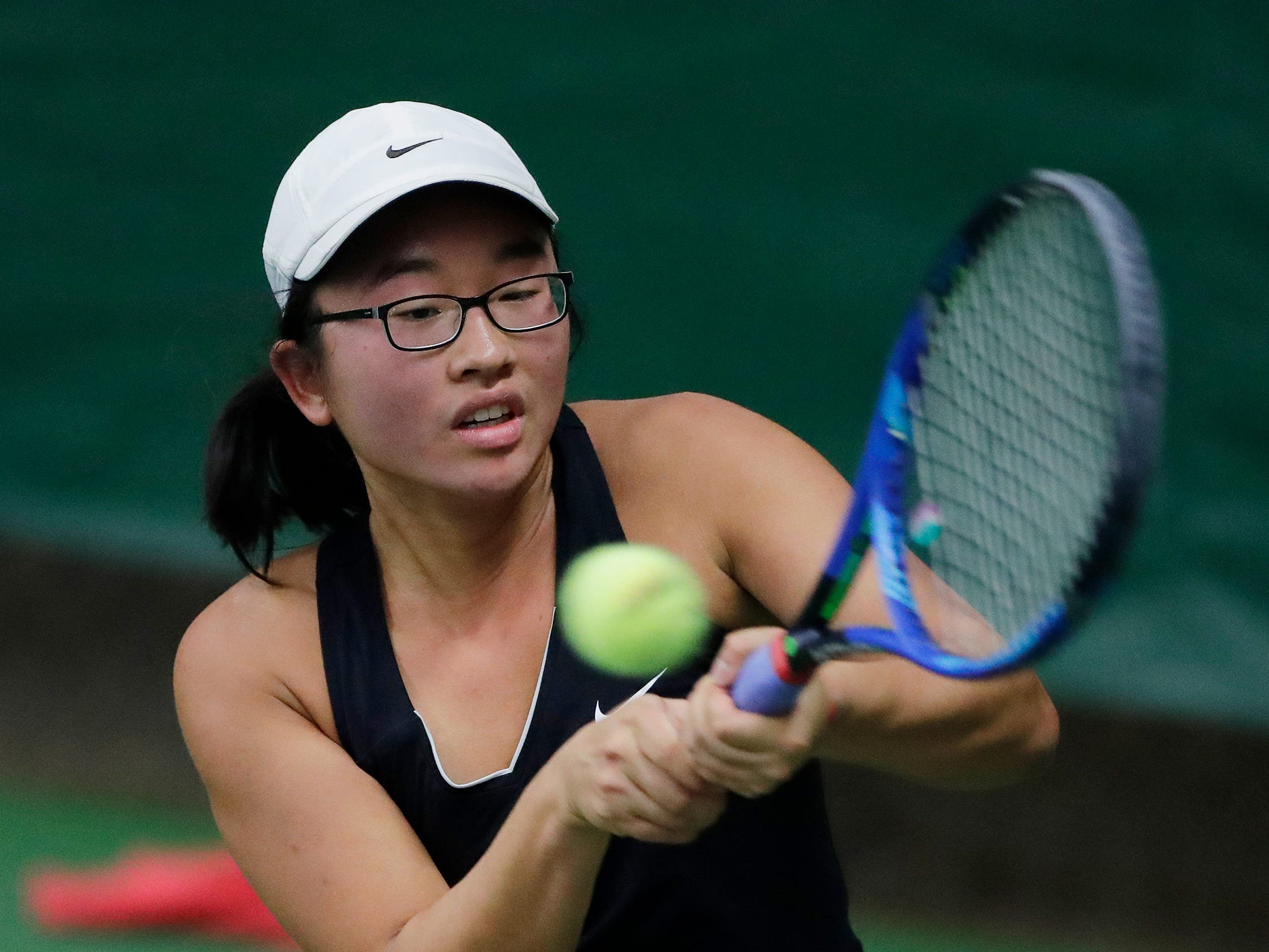 Stevens Point's Sabrina Tang hits a backhand in a Division 1 singles match at WIAA 2018 Girls State Tennis Tournament at Nielsen Tennis Stadium on Friday, October 12, 2018 in Madison, Wis.