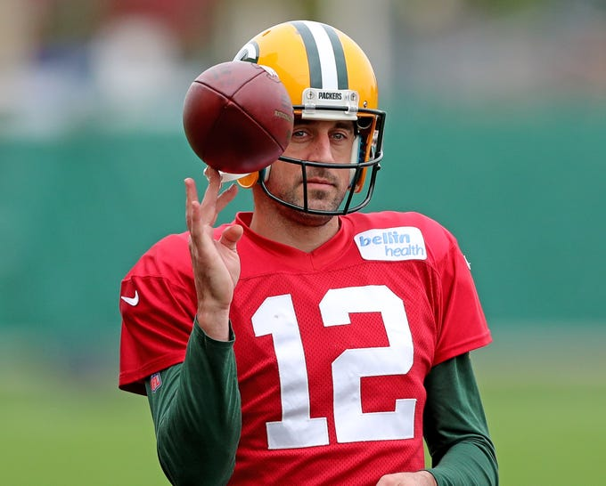Green Bay Packers quarterback Aaron Rodgers (12) spins a ball on his finger while waiting his turn during practice on Clarke Hinkle Field Friday, October 12, 2018 in Ashwaubenon, Wis.