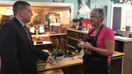 Lucas Marchant, a petition candidate for 13th Circuit Solicitor, talks with voter Pam Cantrell inside her business, My Sister's Store Books & More in Travelers Rest.