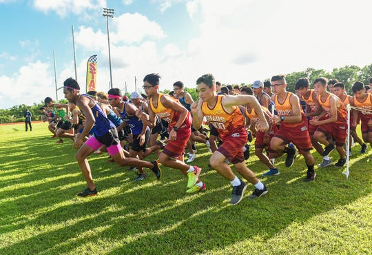 during the IIAAG Cross-Country All Island Championship at Ramsey Field, Oct. 12, 2018.