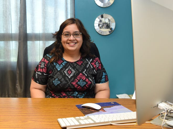 Mary Therese F. Cruz, an assistant professor  of Political Science and Micronesian Studies, in her office at the University of Guam on Oct.12, 2018.