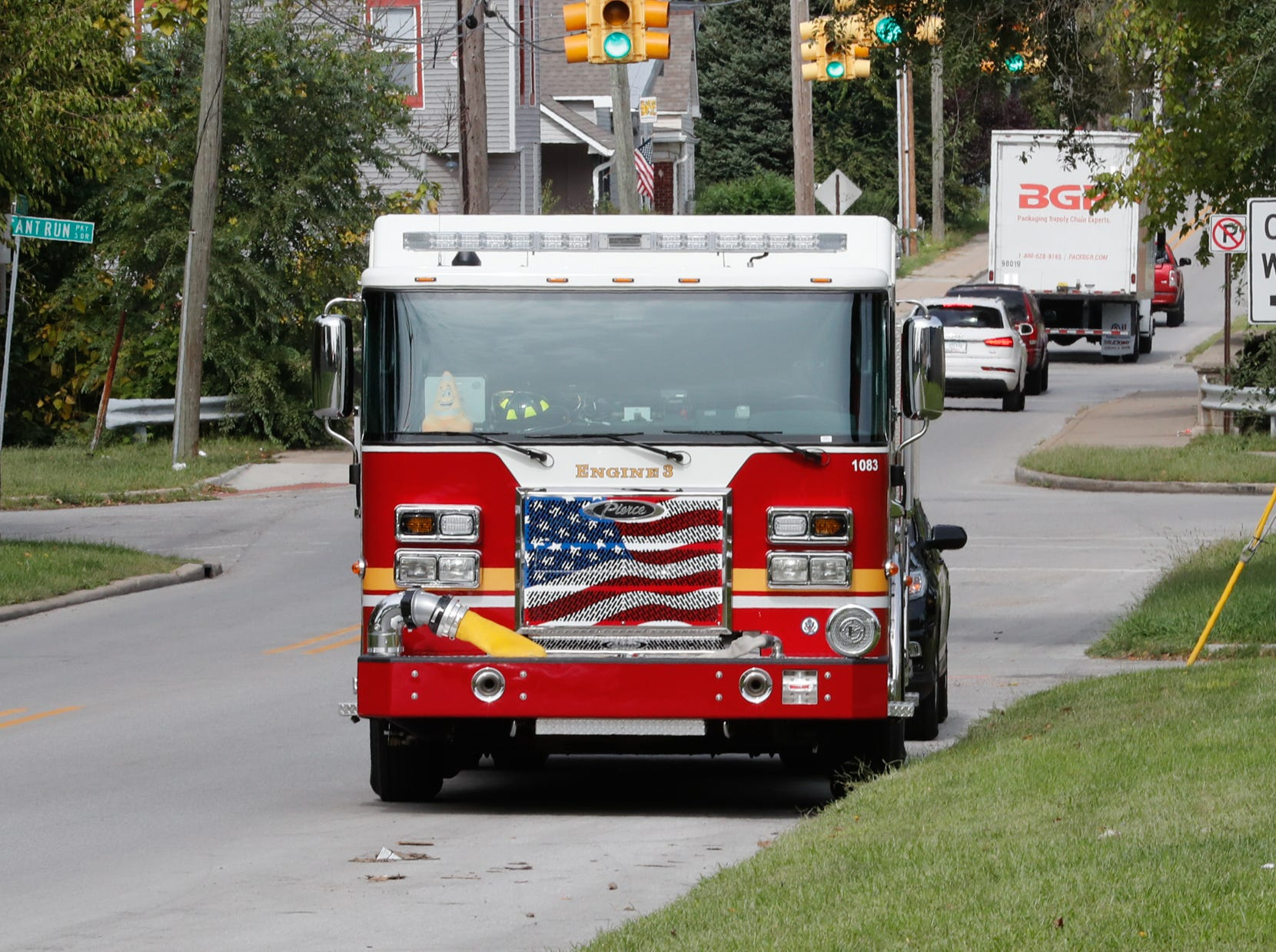 IFD Engine 3 parks near the intersection of Pleasant Run Parkway and State St. during IFD's home safety blitz in Indianapolis for National Fire Prevention Week, on Friday, October 12, 2018. IFD chose the area around IFD Station 15 which experienced 9 residential fires in 2018 for the blitz.
