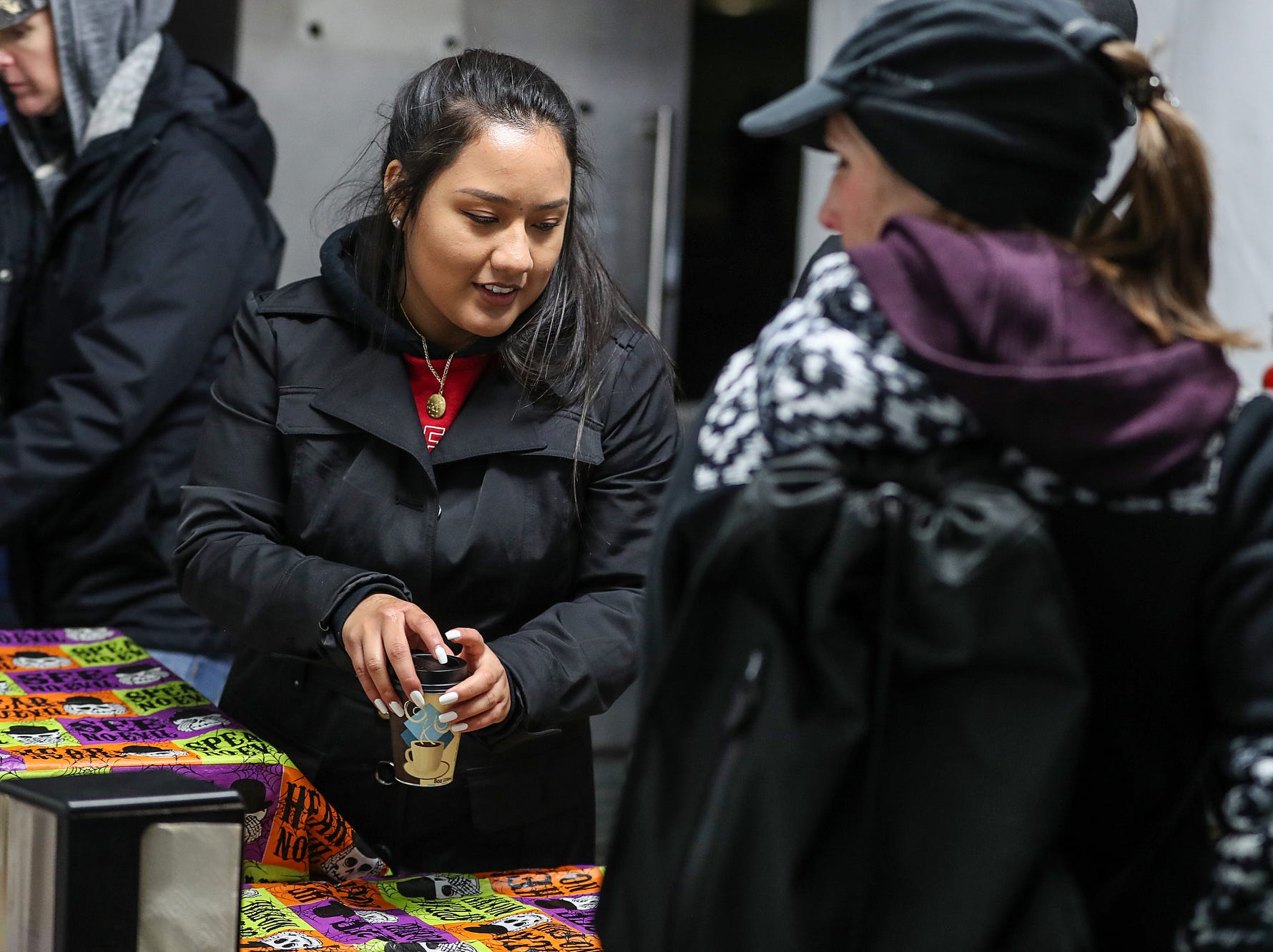 Hot chocolate is sold on opening night of the annual Headless Horseman Halloween festival at Conner Prairie in Fishers, Ind., Thursday, Oct. 11, 2018. The festival is held from 6 to 9 p.m. every Thursday through Sunday, ending Oct. 28, 2018.