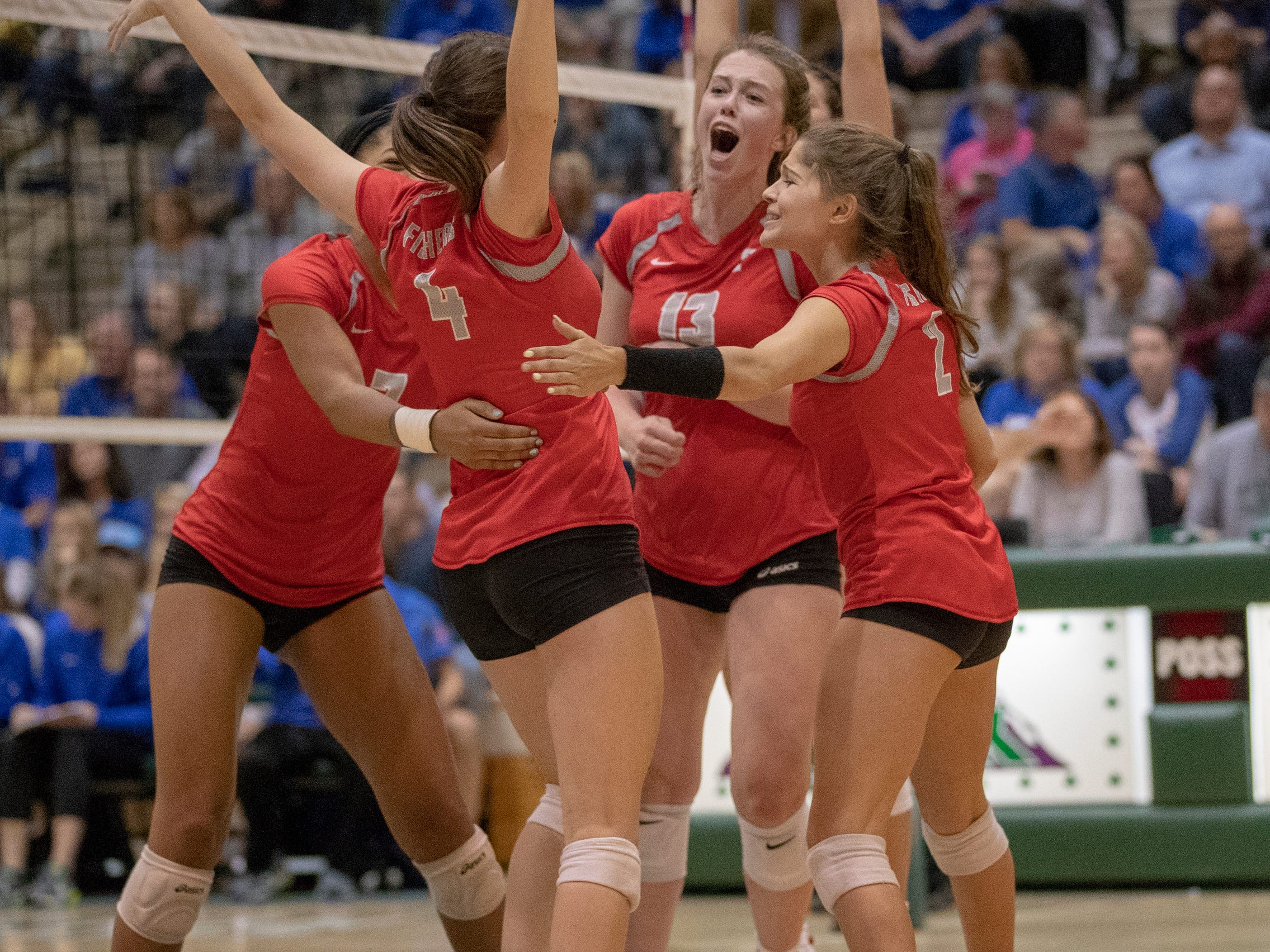 Fishers High School cheers a point as they defeat Hamilton Southeastern High School in three straight sets in the first round of the sectional at Westfield High School, Westfield, Thursday, Oct. 11, 2018. The win matches them up with Westfield High School for a game on Saturday morning at 11a.m.
