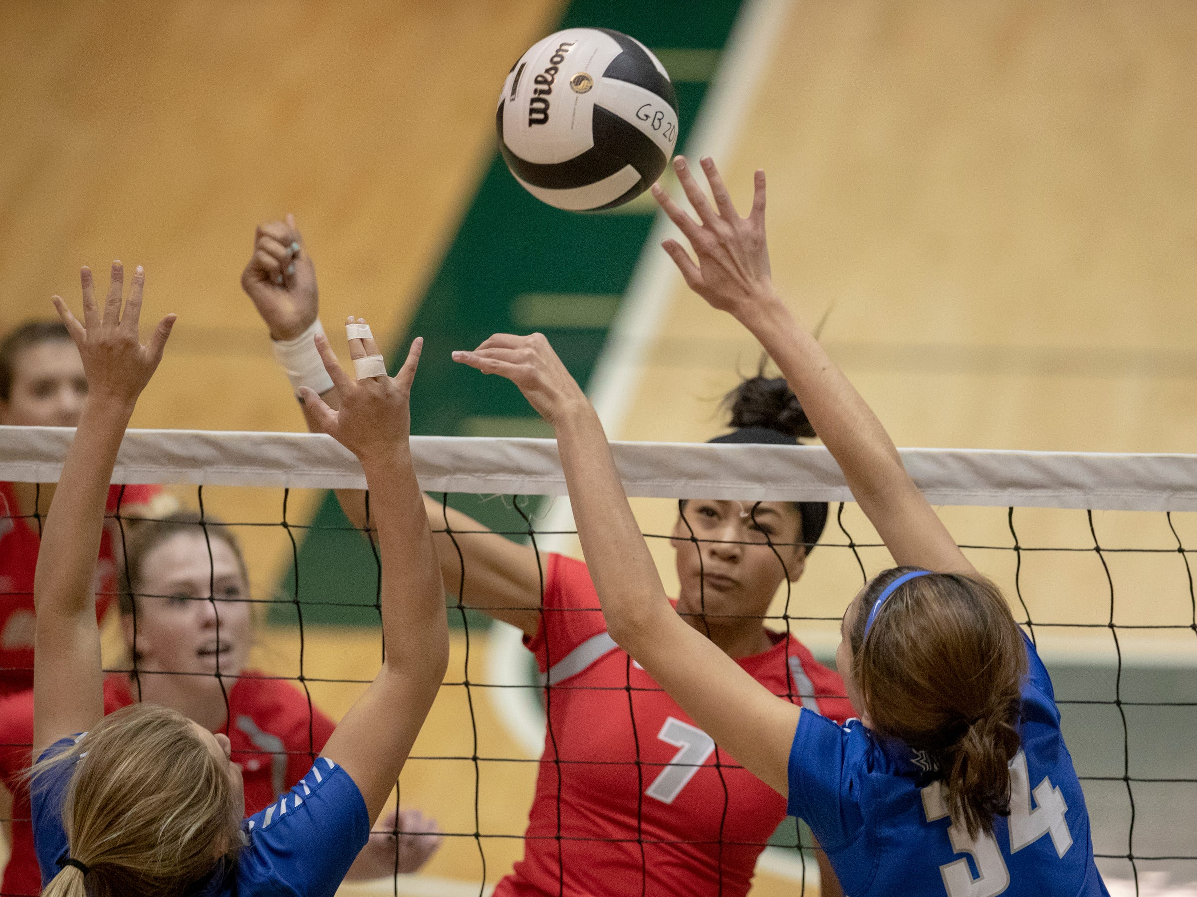 Hamilton Southeastern High School (foreground), and Jada Allen of Fishers High School work at the net as FHS wins in three straight sets in the first round of the volleyball sectional at Westfield High School, Westfield, Thursday, Oct. 11, 2018. The win matches them up with Westfield High School for a game on Saturday morning at 11a.m.