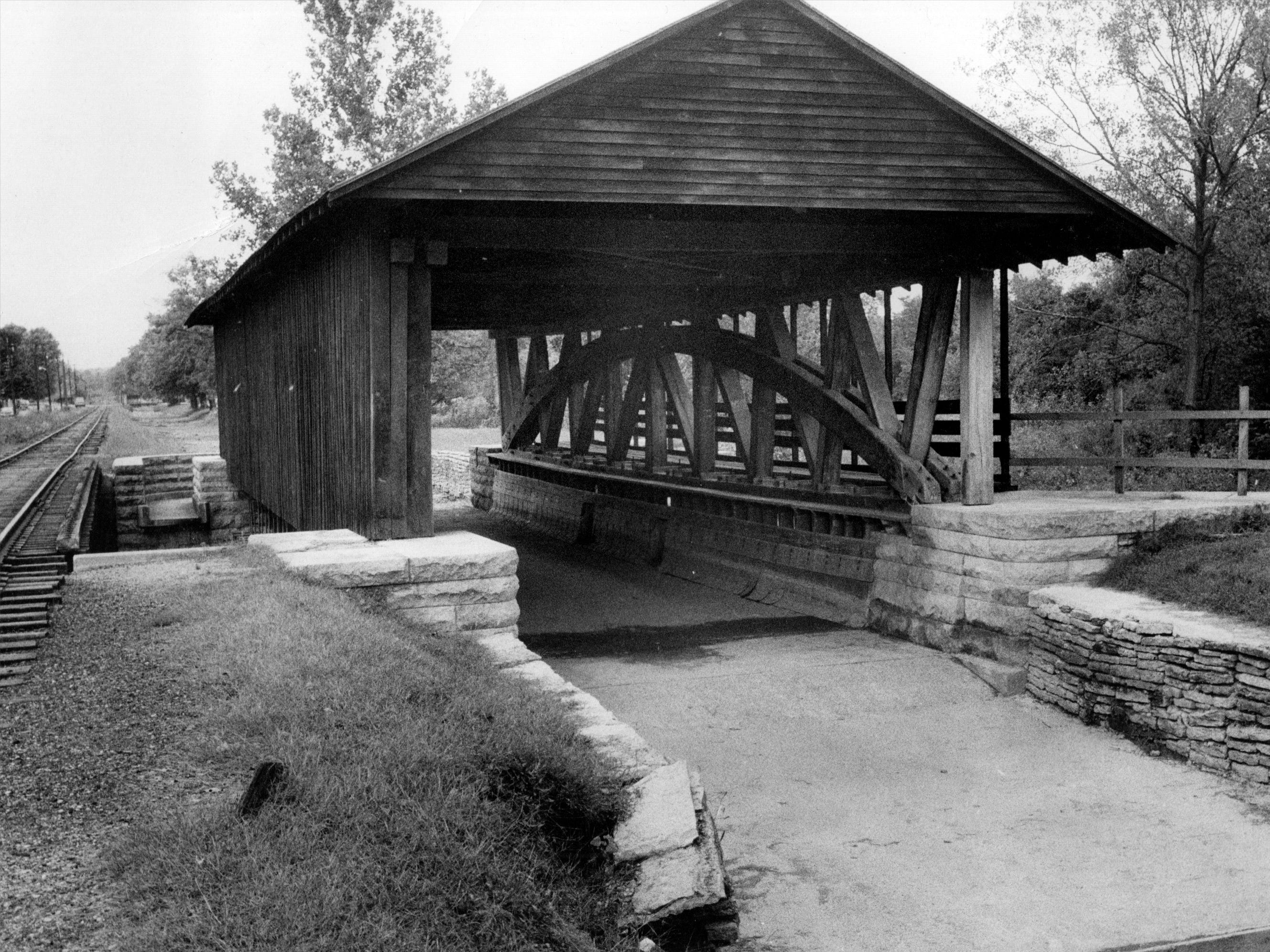 Instead of being built to carry traffic over a stream, this bridge built in 1840s in Brookville was built to carry the Whitewater Canal over the west fork of Whitewater River at the east edge of Metamora. Photo taken in 1968.