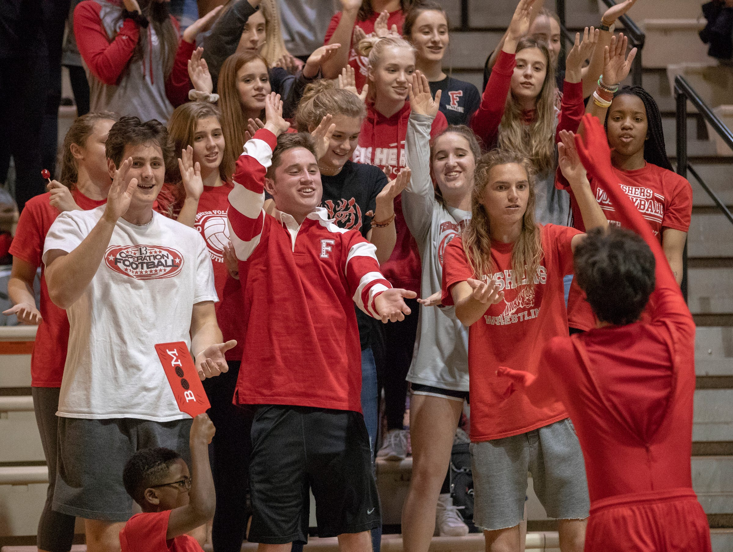 Fishers High School volleyball fans cheer as their team defeats Hamilton Southeastern High School in three straight sets in the first round of the sectional at Westfield High School, Westfield, Thursday, Oct. 11, 2018. The win matches them up with Westfield High School for a game on Saturday morning at 11a.m.