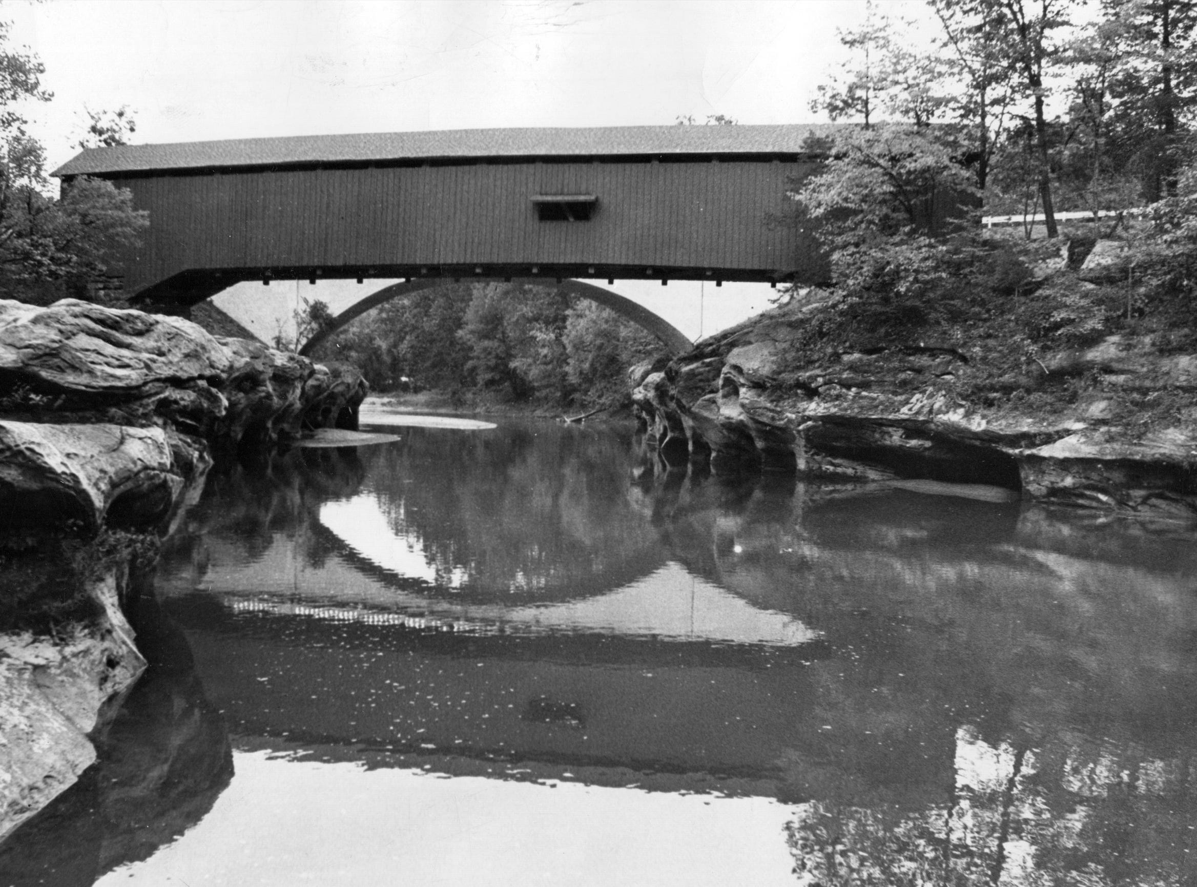 The Narrows Bridge over Sugar Creek on the boundary of Turkey Run State Park in Park County in 1970. The Narrows bridge is one of the most photographed covered bridges in the state.